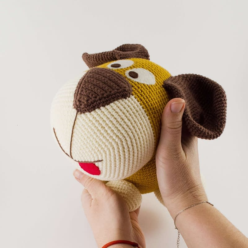 holding big dog toy in my hands