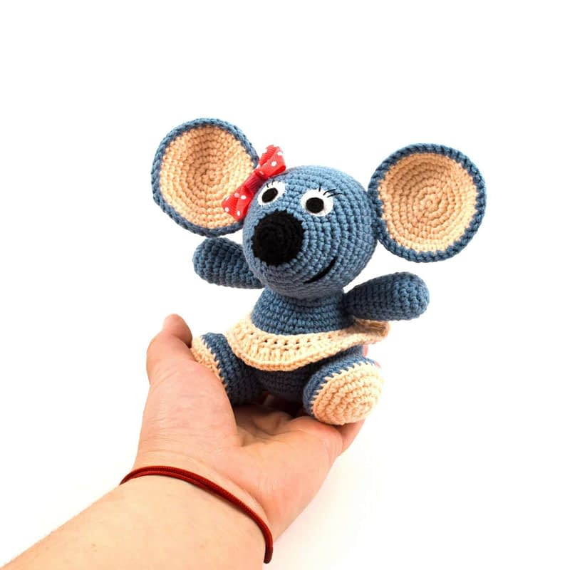 holding in hand crochet mouse toy