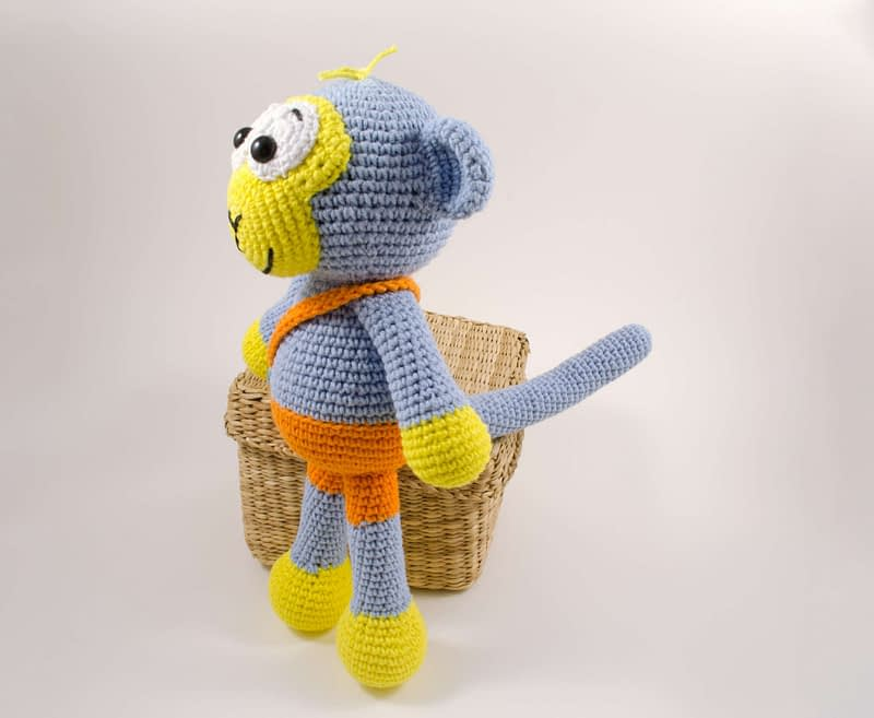 amigurumi blue monkey side view