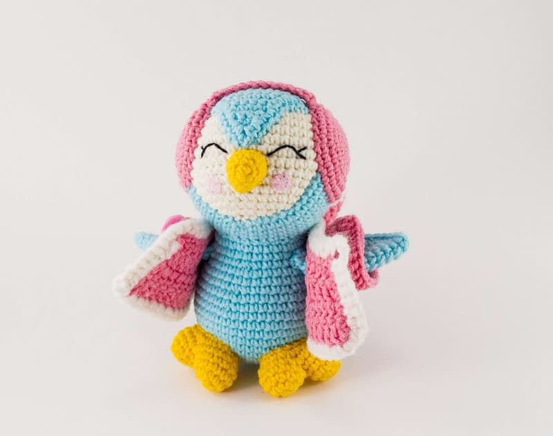 blue penguin with coat