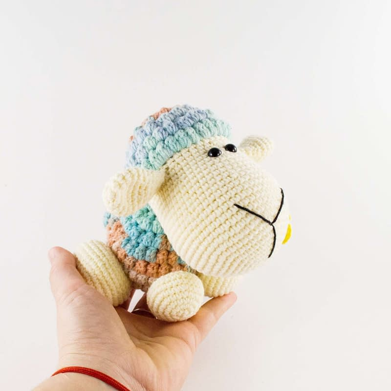 holding in hand crochet sheep