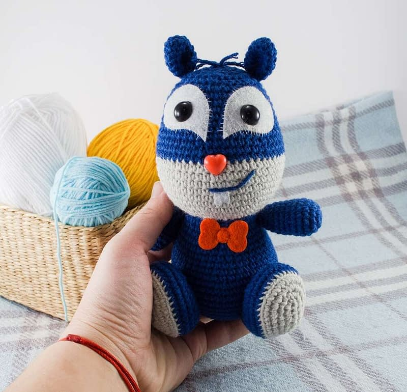 holding in hand crochet squirrel toy