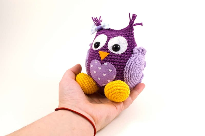 holding in hand crochet purple owl