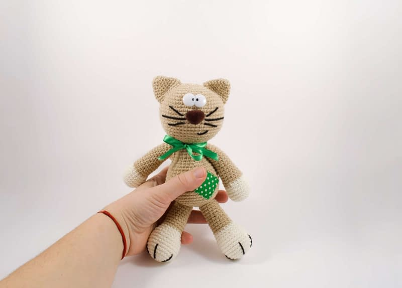 holding in my hand amigurumi cat