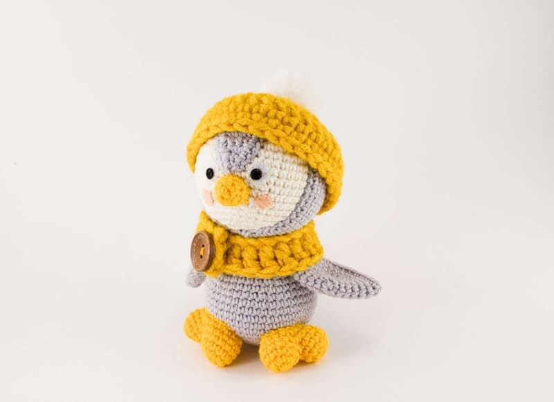 grey penguin with hat and scarf