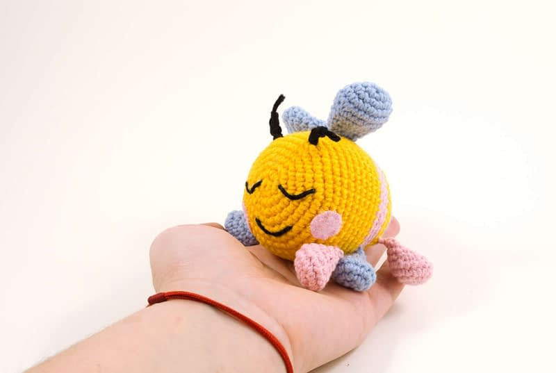 holding in hand bibi the bee
