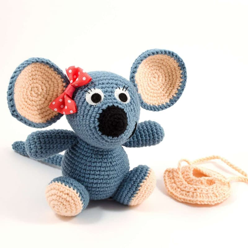 crochet mouse toy and pink skirt