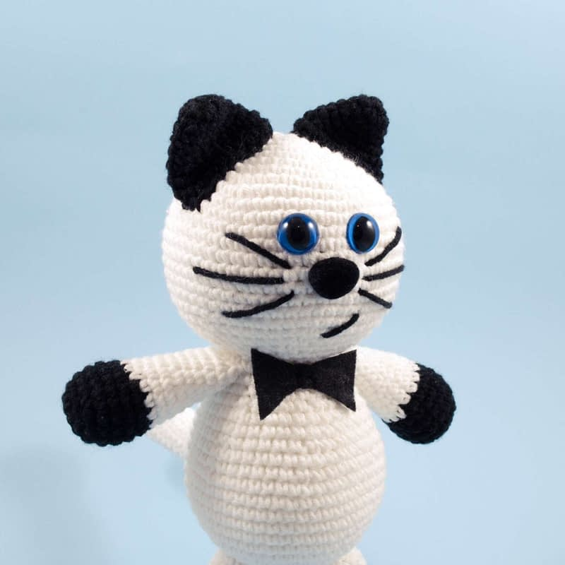 crochet black and white cat close up view