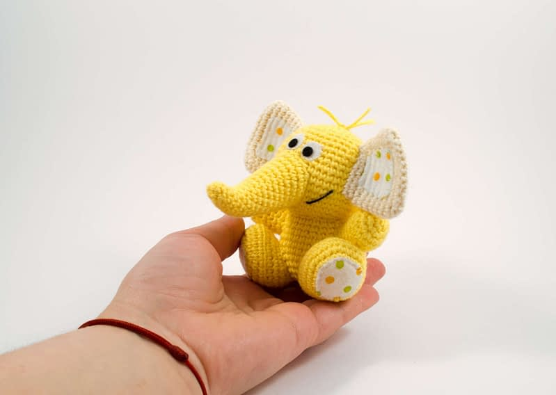 holding in hand cute elephant toy