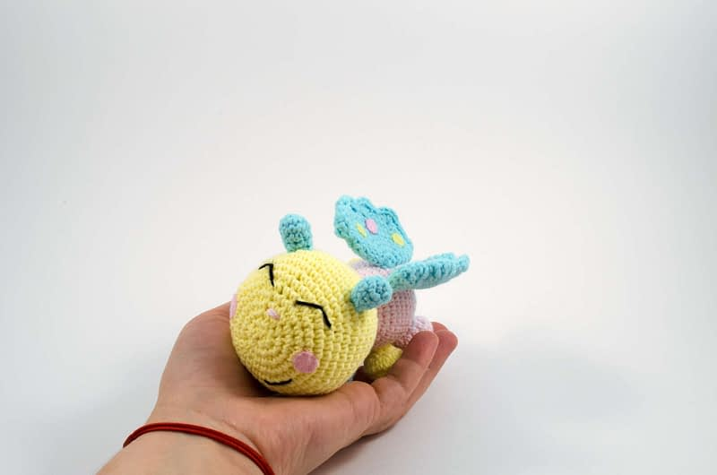 holding in hand baby butterfly toy