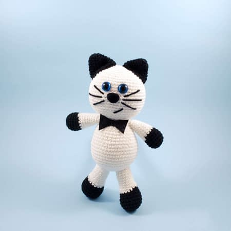crochet black and white cat front view